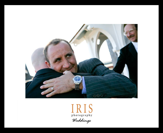 Man-hugging-Chris-with-watch